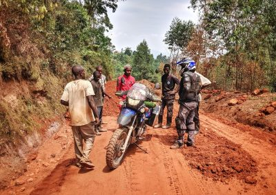 Help from locals on a fall in Bwindi